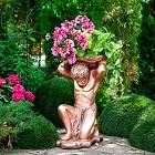 Бронзовые скульптуры в саду